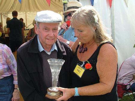 Mary presents Sid Smith with his trophy